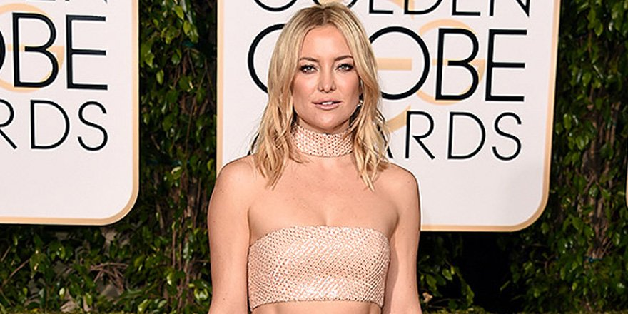 Kate Hudson skis in a sports bra, because of course she does