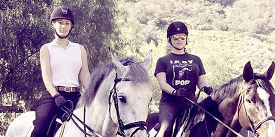Kesha goes horseback riding with Iggy Azalea after judge dismisses abuse claims