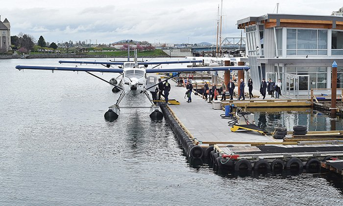 Cover shot by @DonDenton1. Passengers board a Harbour Air seaplane. Terminal was officially open for use Monday.#yyj https://t.co/KNBhKSOujG
