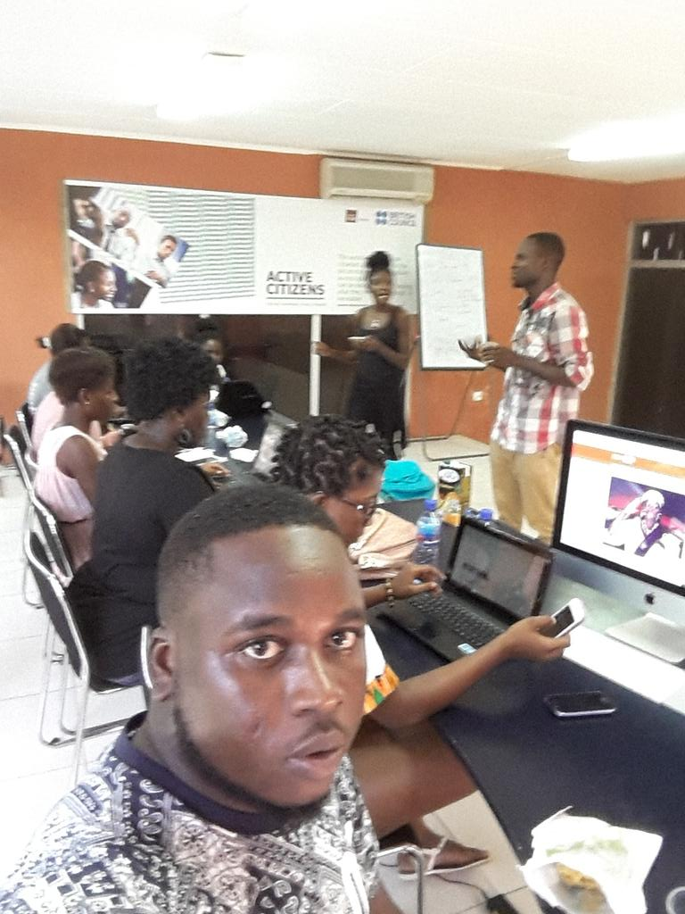 Two guys in an #Artandfeminism edit-a-thon writing articles on Ghanaian feminism content on Wikipedia @hubaccra