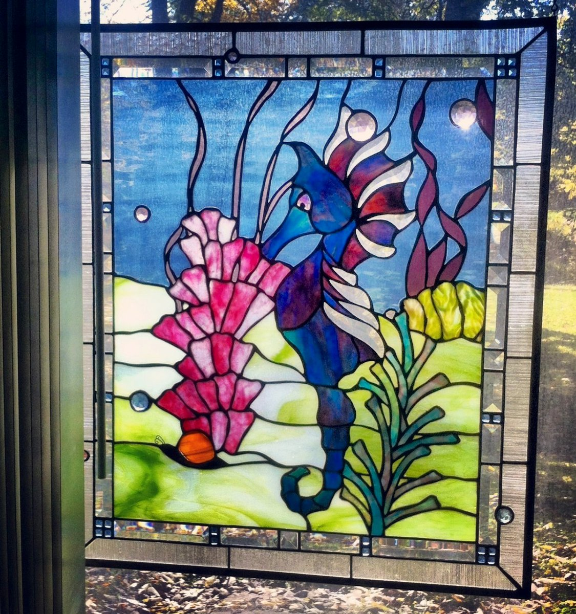 ...a favorite seahorse panel I made years ago and still enjoy every day. #stainedglass #ocean #jeweled #glass #art https://t.co/HSJs9oq6gL
