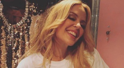 Is it the 80s again?! Gorgeous Kylie Minogue shows off tight curls after getting a perm