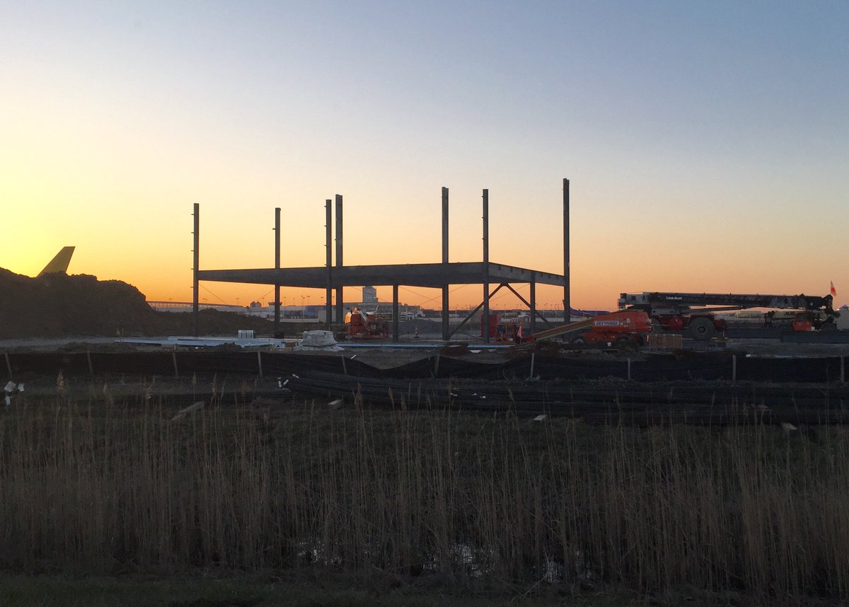 1st structural steel flies into place on a new $31.7 million @SpiritAirlines maint. hangar.
