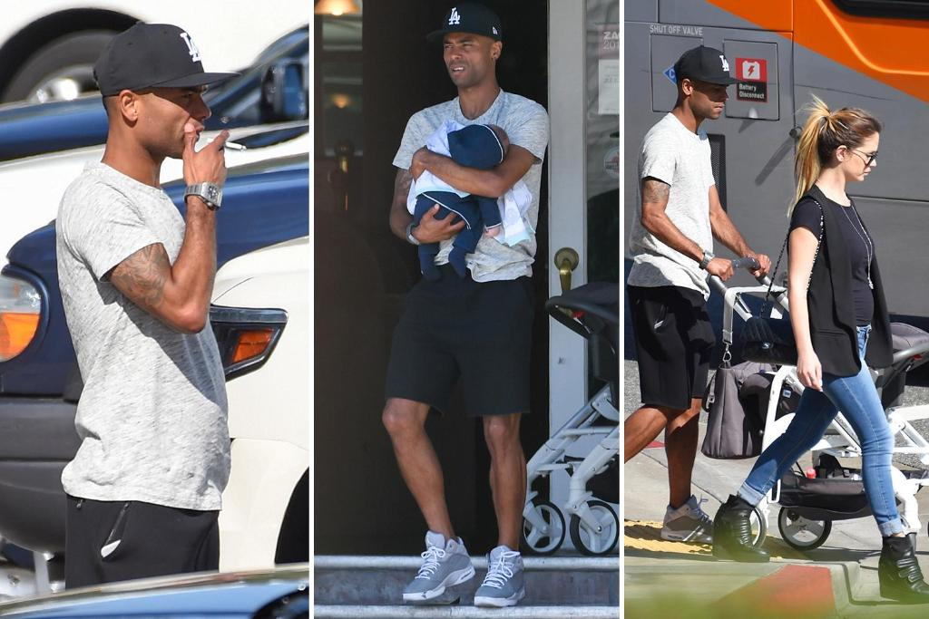 Ashley cole cradles new baby son while out and about in la ...