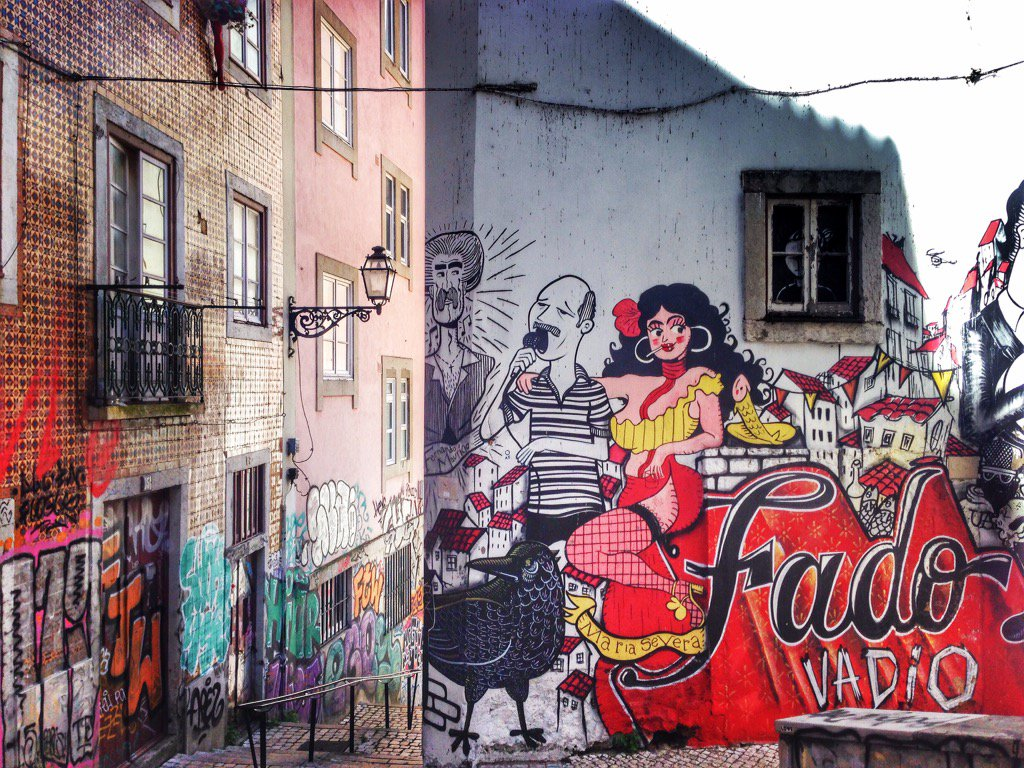 """Earth without """"art"""" would just be """"eh"""".Love the streetart in #Lisbon, here honoring the art of Fado. #portugal https://t.co/tiQPrGxOq6"""