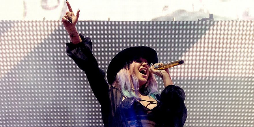 Kesha parties at Neon Carnival after performing with Zedd at