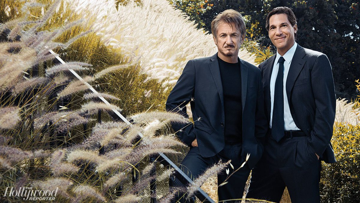 Hollywood's power lawyers pose with clients Harrison Ford, Sean Penn