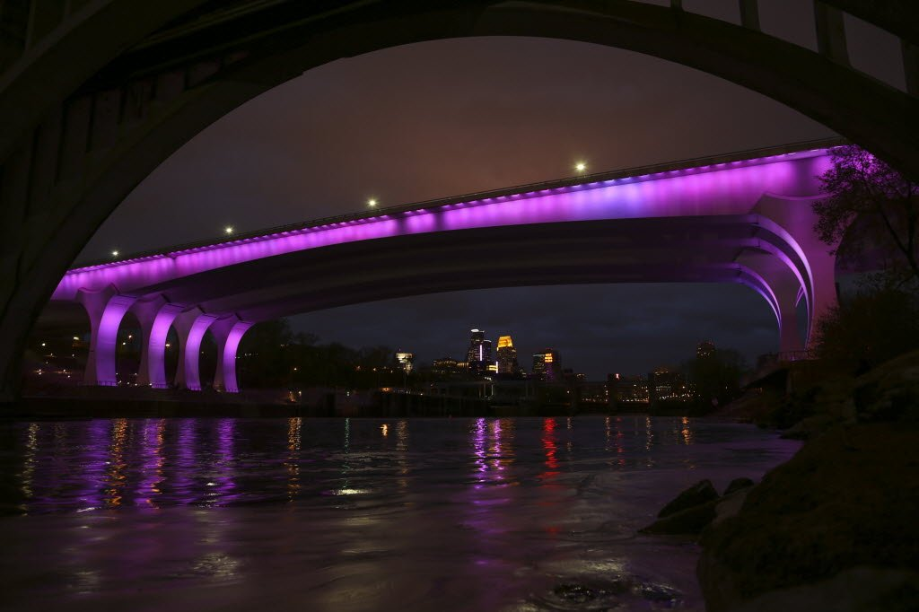 Views Of The I 35w Bridge In Minneapolis Bathed In Purple
