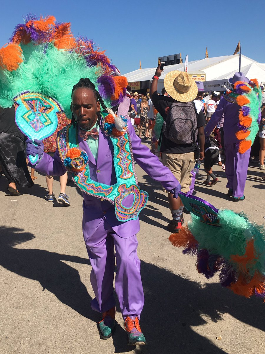 Divine Ladies, Family Ties, & Dumaine St. Gang second line at @jazzfest. #JazzFest #jazzfest2016 https://t.co/DH17hUbP4f