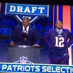 """Kevin Faulk dons Brady shirt next to Troy Vincent. Announces pick """"the New England Patriots AND Tom Brady select..."""" https://t.co/NGr0cfjEdX"""