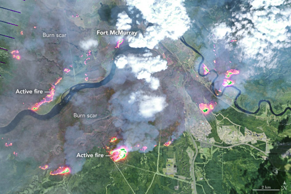 Just-released @NASAEarth image of #ymmfire Wed. Imagine what Thu. image will look like. https://t.co/sE8TOgbDe3 https://t.co/HF0iCd6bs1