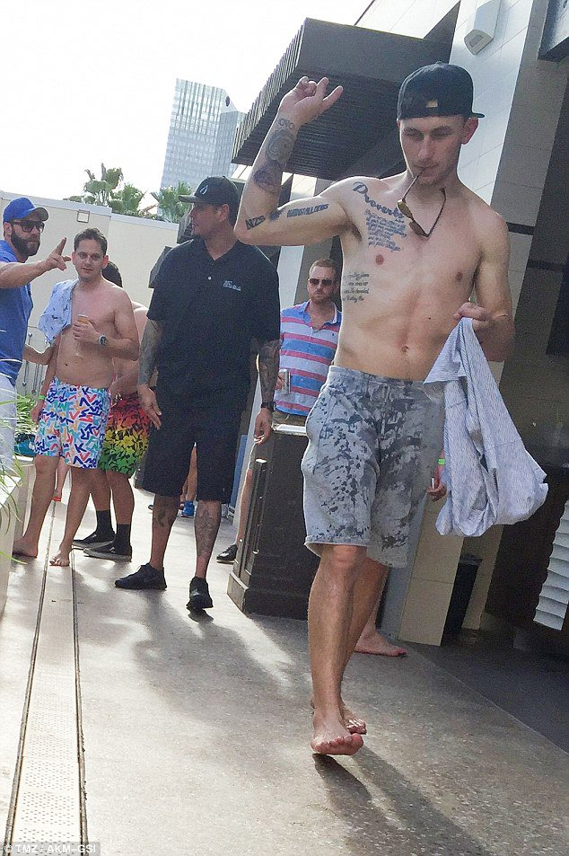 Johnny manziel shows off new tattoos at vegas pool party for Pool party daily show