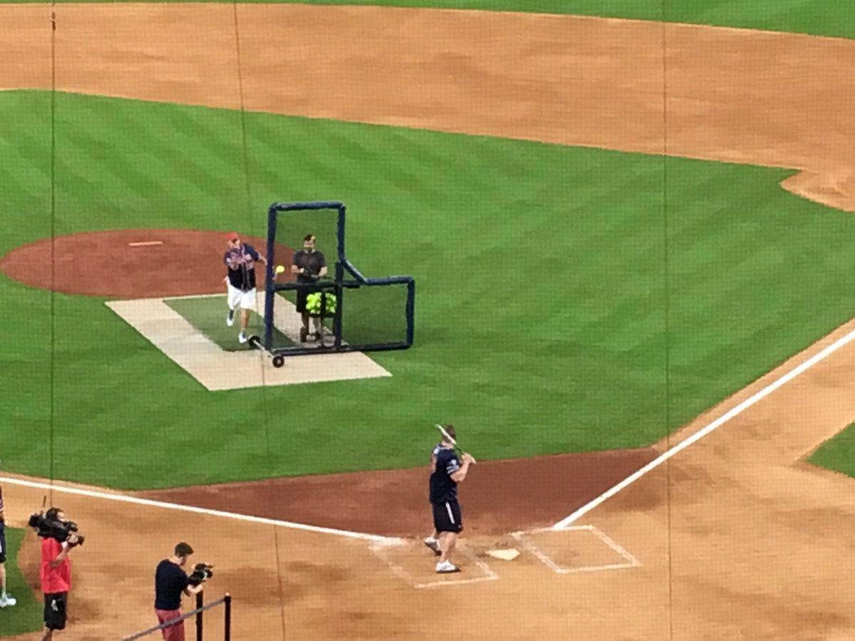 That's Roger Clemens pitching softballs to J.J. Watt. Quite a Houston sports moment. #Texans https://t.co/c8DXnGqhVq