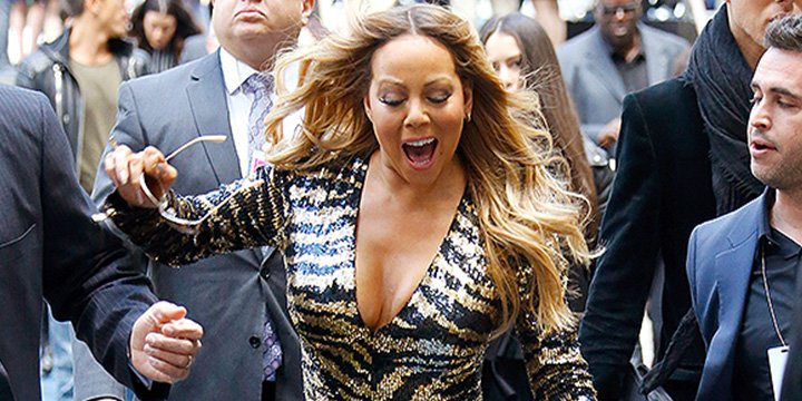 Mariah Carey loses a shoe and her balance while on the NBCUpfronts red carpet