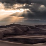 Light breaks through stormclouds in a spellbinding pic at Great Sand Dunes National Park by Ryan Resatka #Colorado https://t.co/58yV8aZ88r