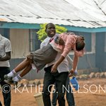 A student carries his classmate out of their school in Kibera after #Kenya police fired teargas into the school. https://t.co/ygUVD2dexN
