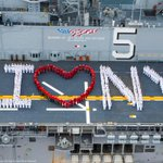 "Sailors onboard the USS Bataan (@LHD5)​ pose for an ""I heart New York"" photo in preparation for #FleetWeekNYC. https://t.co/cSIAPyFN2g"