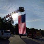 Giant American flag unfurled at church in preparation for #AuburnPolice officer Ronald Tarantinos wake. #7News https://t.co/Nilu6MjLKK
