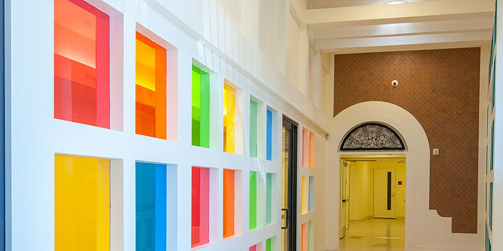 Cheerful colors of Glass create an upbeat transition in this community center hallway. #interiordesign #glass #color https://t.co/JJYZuxJFXV