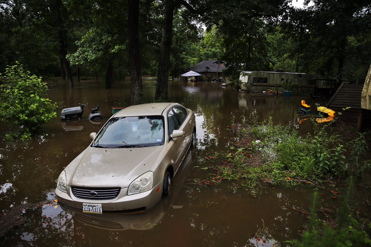 Photo: Flooding in Magnolia, Texas, following overnight heavy rains -  @MichaelCiaglo