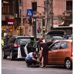 Policeman in Bucharest changing a flat tyre for a lady.  #Romania #kindness #chivalry Photo by Octav Dragan https://t.co/OtlZ0VZiD4