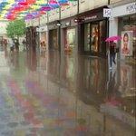 Bath umbrellas reflected in a rain soaked St Lawrence Street #Southgate #bath #bankholidayweather #bath https://t.co/4KruGJXdiv
