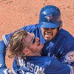Photo: Travis gives #BlueJays a lift, then gets one from Donaldson: https://t.co/FpMp0uPdAA https://t.co/R8sRNWgHVW
