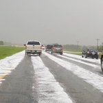Hail covering the road east of Grand Forks AFB. Report of 1 vehicle sliding into the ditch. Photo credit: Mark Okabe https://t.co/wcZXzHQsLc