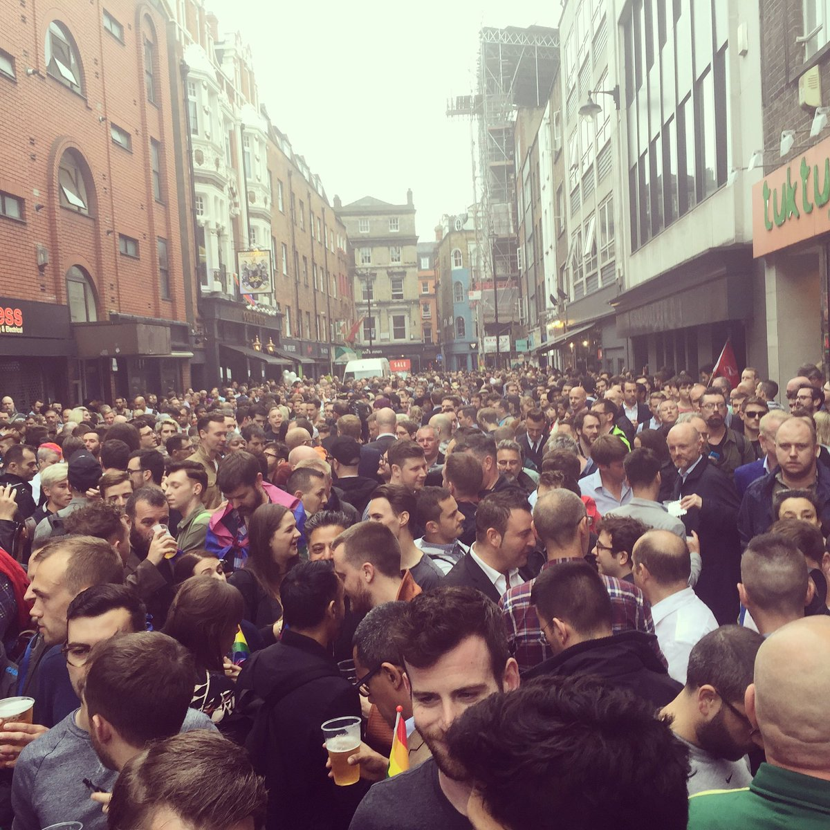 On a rammed Old Compton Street where everyone is preparing to pay their respects to all those killed in #Orlando https://t.co/hyjC05Bi3K