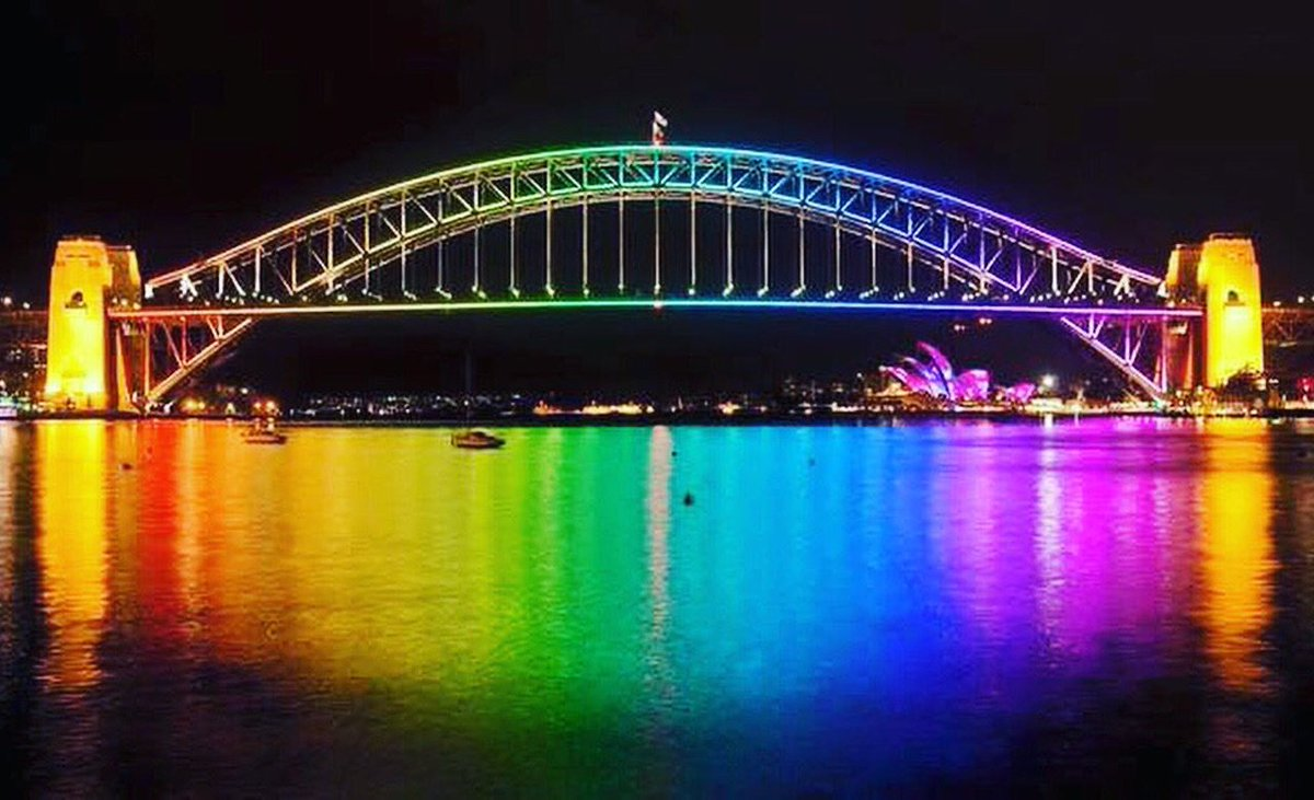 Australia's landmarks light up in honour of Orlando deaths. Image via @SydneyWaterNews. https://t.co/YriCnpKPqP https://t.co/lejYFdRyjE
