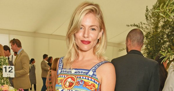 Sienna Miller is bohemian chic in a printed Dolce & Gabbana dress: