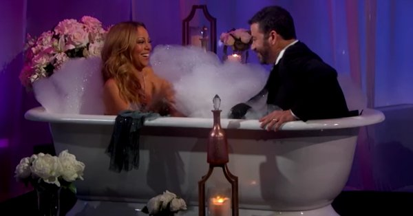 Mariah Carey & Jimmy Kimmel do an interview while soaking in a glamorous bathtub: