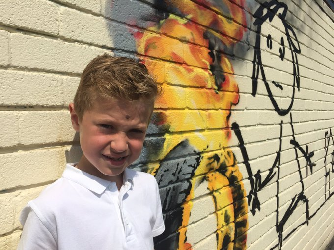 It was seven-year-old Charlie who chose to name one of the school houses after #Banksy - and got a mural in return