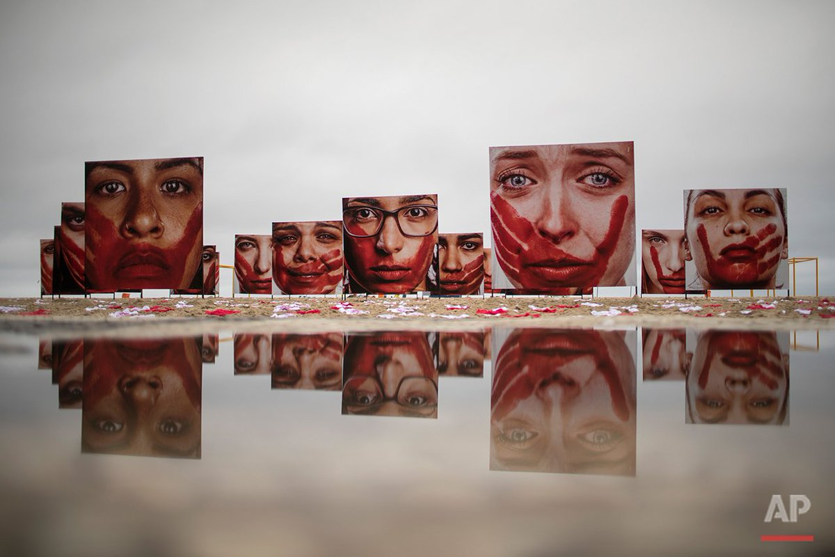"""Photos titled """"I'll Never Be Silent"""" displayed in protest to rape & violence against women in #Brazil. @felipedana https://t.co/1JGIon2vBe"""