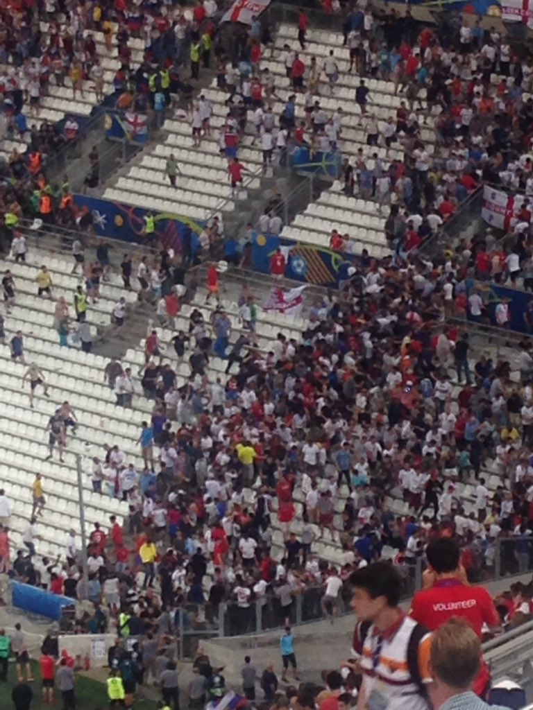 #rus fans going into #eng section and attacking fans. Horrible scenes. https://t.co/DcQ0OdfOKy