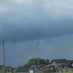 Funnel cloud spotted just before noon over the city of Warman. Photo courtesy Lisa Tee. #skstorm #Sask #yxe https://t.co/zTMmZKGxOO