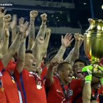 Photo: Alexis Chile lift the Copa America trophy for the 2nd consecutive summer. #afc https://t.co/B2A0b4y73V