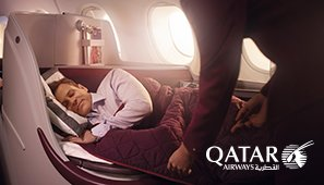 Travel in luxury on board Qatar Airways awarding-winning Business Class.