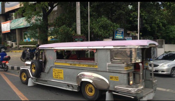2 Jeepneys on the streets of Manila right now....  Love these