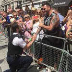 A London police officer proposed to his partner at #Pride2016 and melted everyone's hearts https://t.co/aI73UsaMr7 https://t.co/oQsCDZIw38