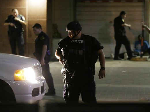 One Dallas suspect holed up in a community college garage has killed himself: (Photo: AP)