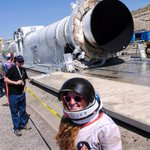 Kendra Toole wears an astronaut costume while looking at a solid rocket motor after it was tested at @OrbitalATK https://t.co/lGLHXjAS5A