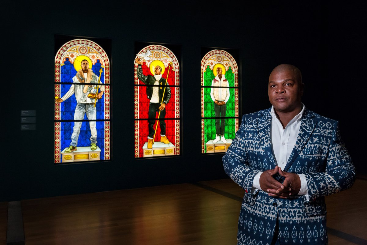 Kehinde Wiley in front of some of his stained glass pieces at #VMFA. #WileyRVA #KehindeWiley https://t.co/zwrwhFwscB