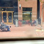 Seen Today: Man in wheelchair reads @sfexaminer #SFHomelessProject story, while homeless man sits cuffed by #SFPD. https://t.co/q17wFs8WyA