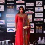 The stunning chairperson of SIIMA @BrindaPrasad1 #SIIMA2016 #Singapore https://t.co/xuFlmVCZG9