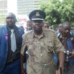 Police spokesman roughed up, forced to carry coffin during lawyers demo