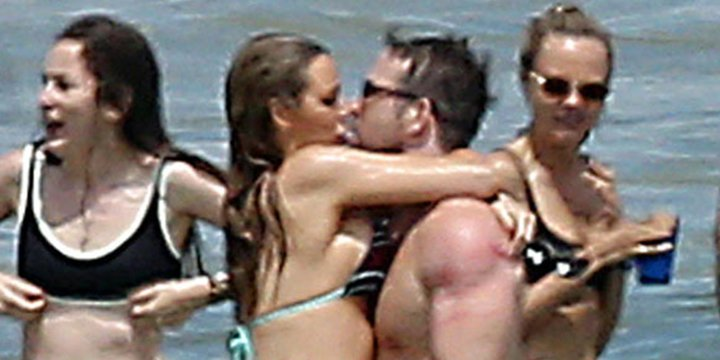 Blake Lively gives Ryan Reynolds a passionate kiss on beach date with Taylor Swift's squad