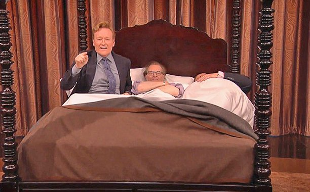 Conan O'Brien is in bed with Larry King. Literally: