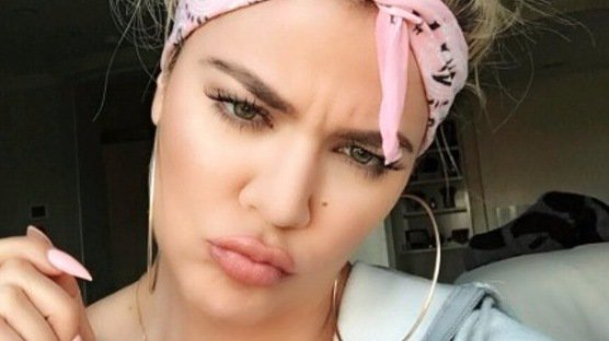 Khloe Kardashian puts her flawless skin down to *these* purse-friendly beauty buys!