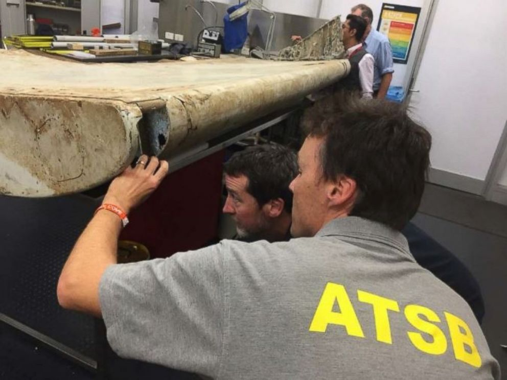 Photos show wing flap believed to be from missing plane MH370, found on island off Tanzania.